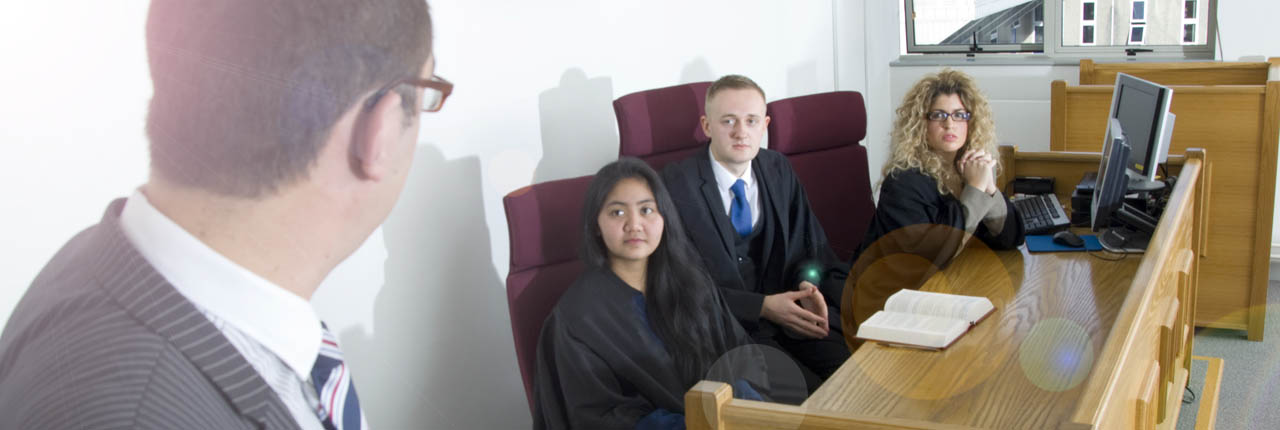 Students using the mock courtroom facilities