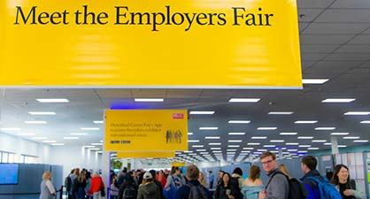 Meet the Employers Fair sign, above students at the fair