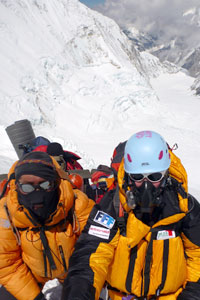 Mollie and team member in breathing gear on Everest