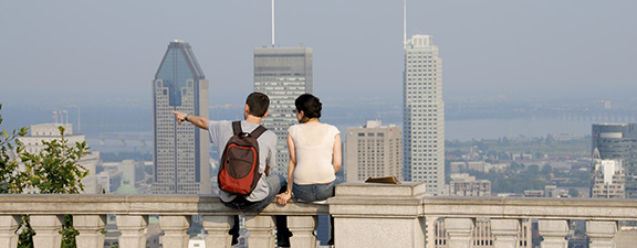 Young people watching the Montreal skyline