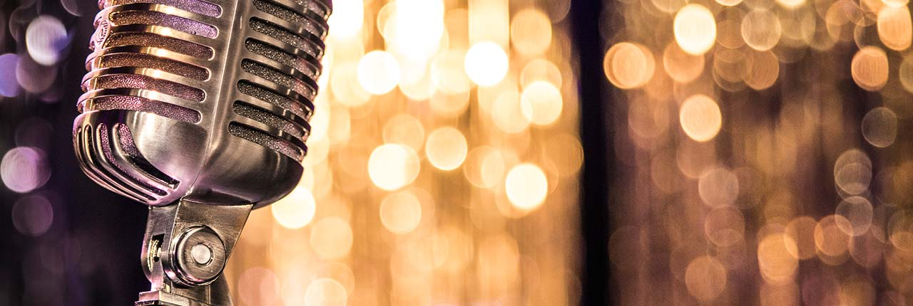 Retro microphone with glittery background
