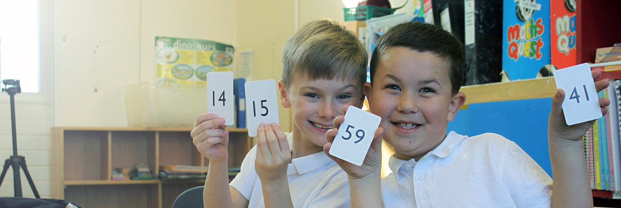 Two school children participating in the Number Partners scheme