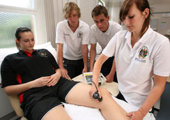 Physiotherapy students assessing a patient