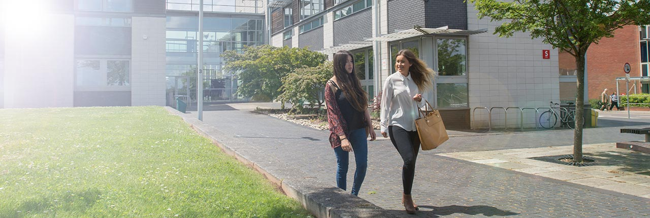 Two students walking on the Frenchay campus