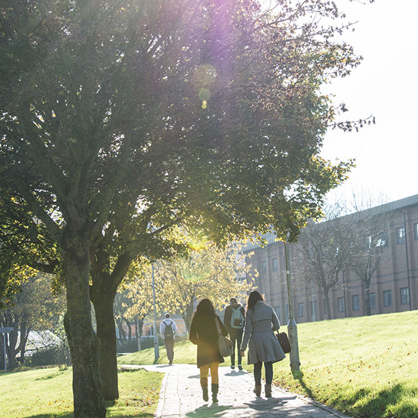 Students walking in the sun around Frenchay Campus