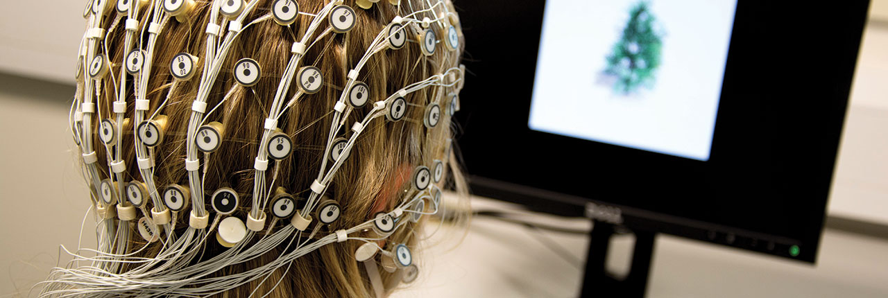 Student undergoing EEG test in Psychology lab