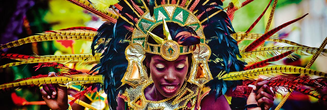 A costumed dancer at the St Paul's Carnival in Bristol