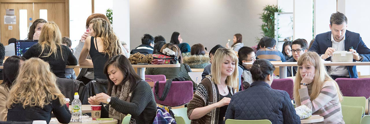 A group of students eating in a cafeteria on Frenchay Campus
