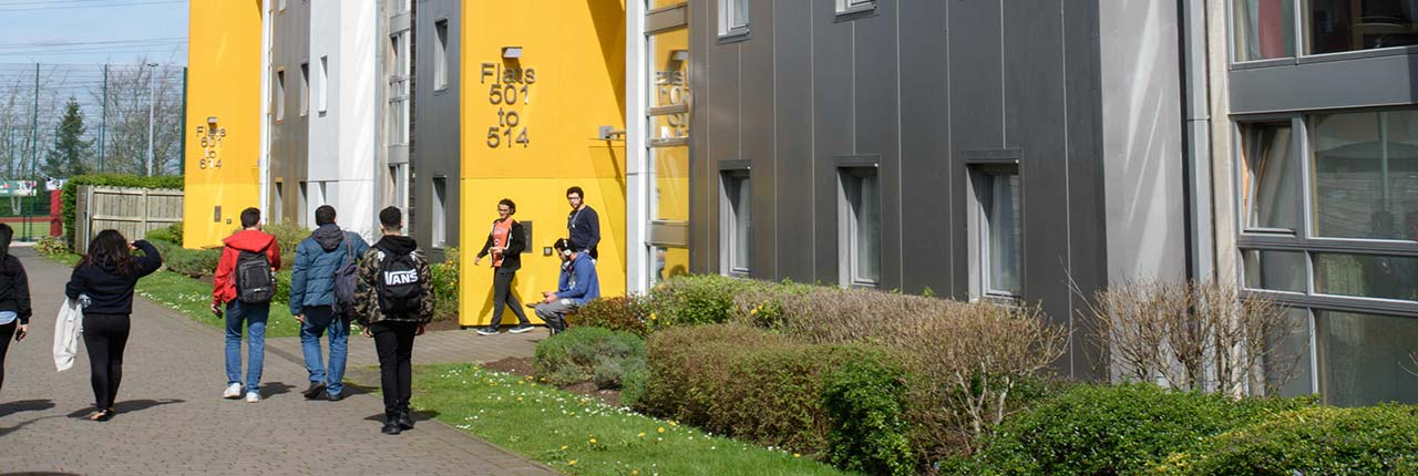 Students walking through the Student Village