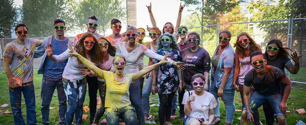 Students taking part in a colour run activity