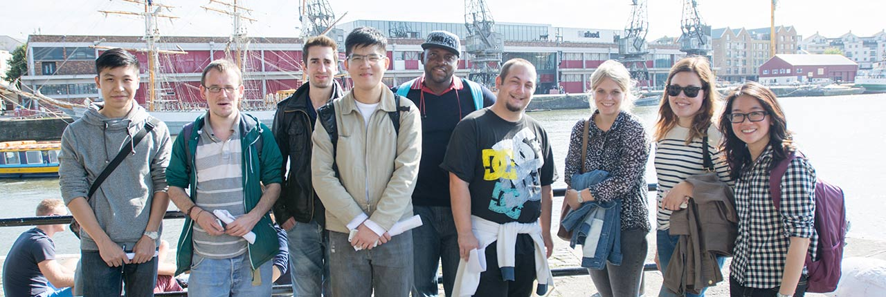 Students standing in front of the Harbourside