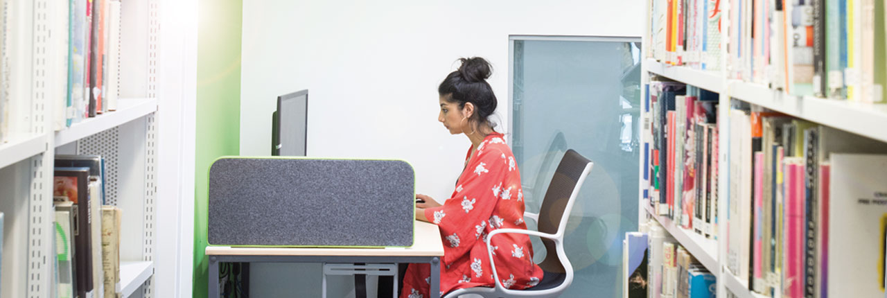 Student working in a UWE Bristol library