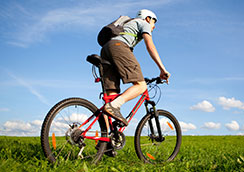 Young male cyclist on grass