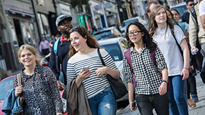 Students walking down a street in Bristol city centre