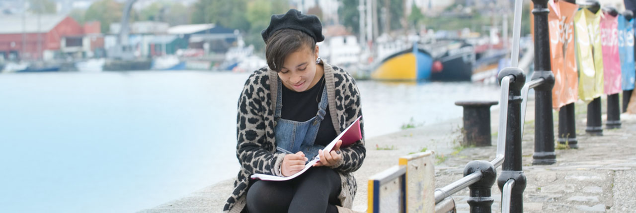 Female student studying in Bristol Harbourside