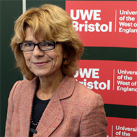 Vicky Pryce photographed in front of the UWE Bristol logo