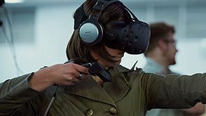 Female student wearing virtual reality headset