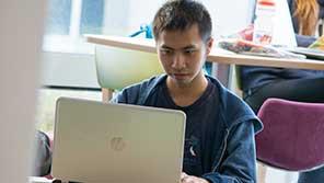 Student on laptop studying