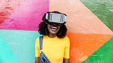 Woman smiling looking through virtual reality software