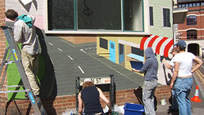 Students painting a wall