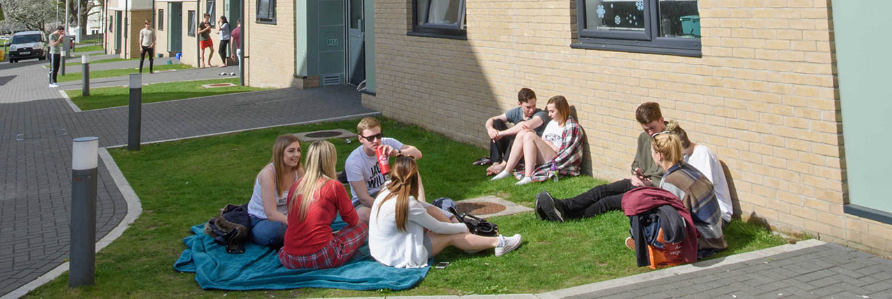 Group of students sitting outside Wallscourt Park student accommodation