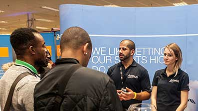 Employers talking to students at a fair
